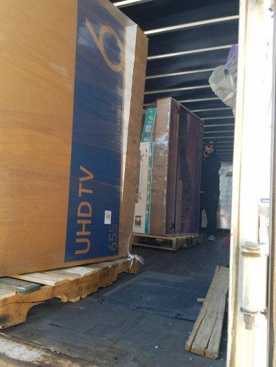 TV Parts World unload truck 1